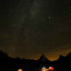 the base camp during the night, with a sky full of bright stars