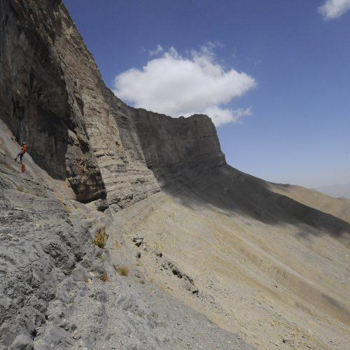 Rappel down on the cliff to finding a cave entrances in the mountain of Uzbekistan